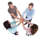 Business people stacking hands over each other. On White Background Stock Photo