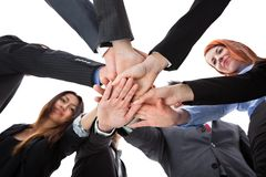 Business people stacking hands. Shot from below Royalty Free Stock Image