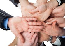 Business people stacking hands. Shot from below Royalty Free Stock Photo