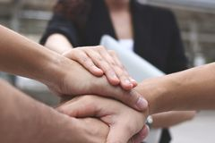Business people stacking hands together. Successful and teamwork concept royalty free stock photos