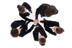 Business people stacking hands. Top view of business people stacking hands isolated on white Royalty Free Stock Photo