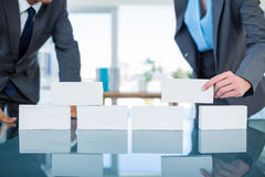Business people stacking paper bloc. In office Stock Photo