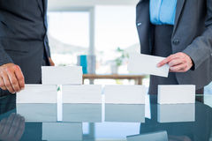 Business people stacking paper bloc. In office Royalty Free Stock Photos