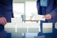 Business people stacking paper bloc. In office Royalty Free Stock Photography