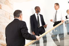 Business people on staircase. Stock Images