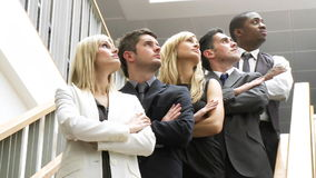 Business people on stairs looking upwards footage stock footage
