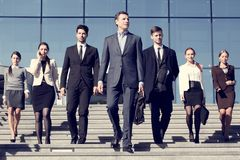 Business people at stairs. Team of diverse business people at stairs of company office building Royalty Free Stock Image