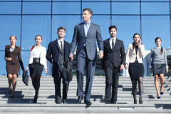 Business people at stairs. Team of diverse business people at stairs of company office building Stock Photos