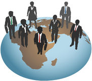 Business people stand on global world Stock Image