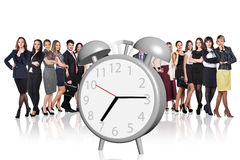 Business people stand near big alarm clock Royalty Free Stock Image