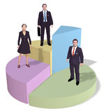 Business people stand on success pie chart Stock Photo