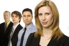 Business people stand together. Four business people stand confidently Stock Photos
