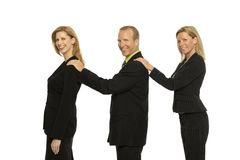 Business people stand together. Three business people stand together and smile Royalty Free Stock Photo