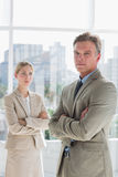 Business people standing with arms crossed Stock Photo