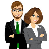 Business people standing with arms folded Stock Photo