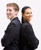 Business people standing back to back. Two business people standing back to back Royalty Free Stock Photography