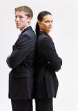 Business people standing back to back. Two business people standing back to back Royalty Free Stock Images
