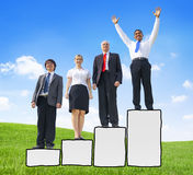 Business People Standing on a Bar Graph Royalty Free Stock Images