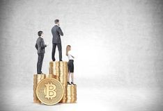 Business people standing on bitcoin stacks indoors Royalty Free Stock Image