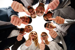 Business people standing in circle. Group of business people standing in circle, with thumbs up Royalty Free Stock Images