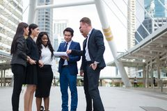 Business people standing in the city and discussing ideas for business future. Multi culture of business people, African, Caucasian and Asian royalty free stock images