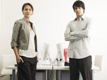 Business People Standing At Computer Desks Stock Photography