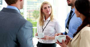 Business people standing at conference drinking coffee stock video footage