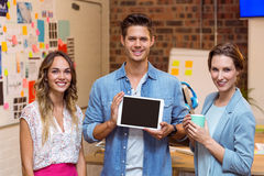 Business people standing with a digital tablet Stock Image