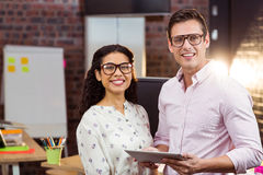 Business people standing with a digital tablet Stock Photos