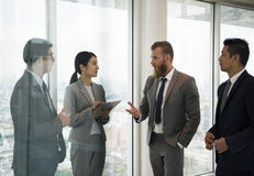 Business people standing discussing about the meeting. Business Discussion Meeting Presentation Briefing stock photography