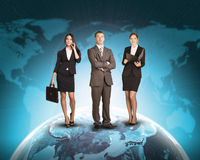 Business people standing on Earth surface. Background is world map with blue gradient. Elements of this image furnished by NASA Royalty Free Stock Photos