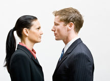 Business people standing face to face Stock Photo