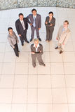 Business people standing on floor royalty free stock image