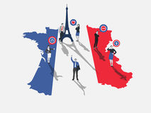 Business people standing on france with flag colours Stock Photo