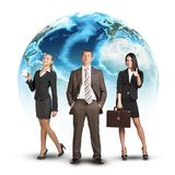 Business people standing in front of Earth Stock Photo