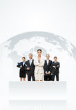 Business people standing in front of an earth map royalty free stock images