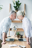 Business people standing head to head. Senior business people standing head to head Royalty Free Stock Image