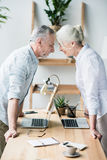 Business people standing head to head. Senior business people standing head to head Stock Photo