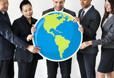 Business people standing and holding globe icon Stock Photography