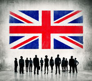 Business people standing infront of the UK flag Royalty Free Stock Photos