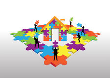 Business people standing on jigsaw puzzle building house Stock Images