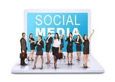 Business people standing on laptop stock photography