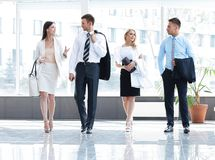 Business people standing in the lobby of the modern office. Stock Images