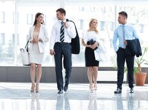 Business people standing in the lobby of the modern office. Royalty Free Stock Photography
