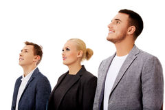 Business people standing and looking away together Stock Images