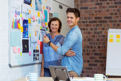 Business people standing near whiteboard Royalty Free Stock Photography