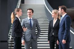 Business people standing in office lobby royalty free stock image
