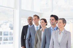 Business people standing in a row Stock Photos