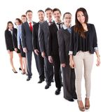 Business people standing in row. Over white background stock photography