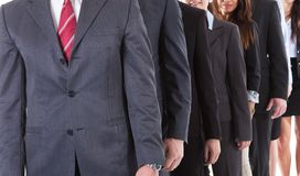 Business people standing in row Royalty Free Stock Images